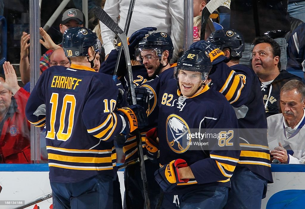 <a gi-track='captionPersonalityLinkClicked' href=/galleries/search?phrase=Marcus+Foligno&family=editorial&specificpeople=5662790 ng-click='$event.stopPropagation()'>Marcus Foligno</a> #82 of the Buffalo Sabres celebrates his second period goal against the Toronto Maple Leafs with teammates on November 15, 2013 at the First Niagara Center in Buffalo, New York.
