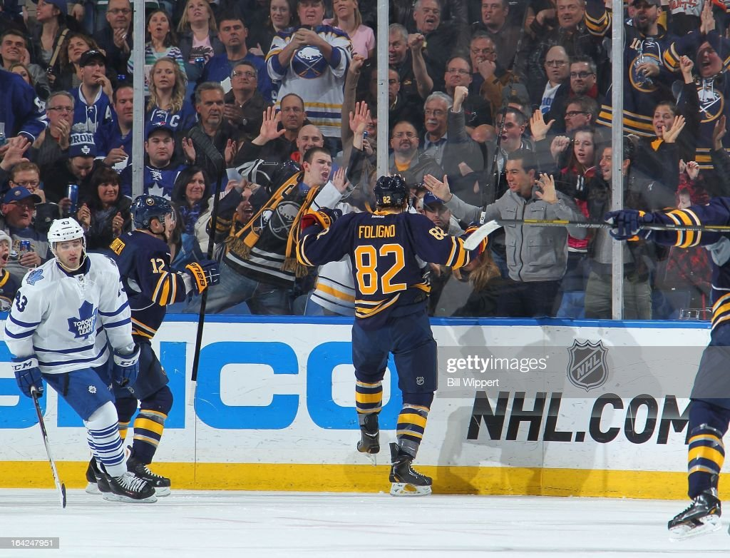Marcus Foligno #82 of the Buffalo Sabres celebrates his second-period goal against the Toronto Maple Leafs with fans on March 21, 2013 at the First Niagara Center in Buffalo, New York.