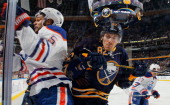 Marcus Foligno of the Buffalo Sabres checks Mark Fraser of the Edmonton Oilers into the glass on February 3 2014 at the First Niagara Center in...