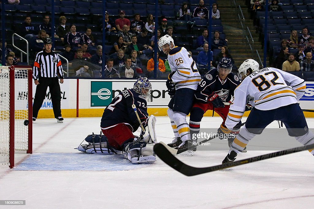 Marcus Foligno #82 of the Buffalo Sabres deflects the puck past Sergei Bobrovsky #72 of the Columbus Blue Jackets for a goal during the first period on September, 2013 at Nationwide Arena in Columbus, Ohio.