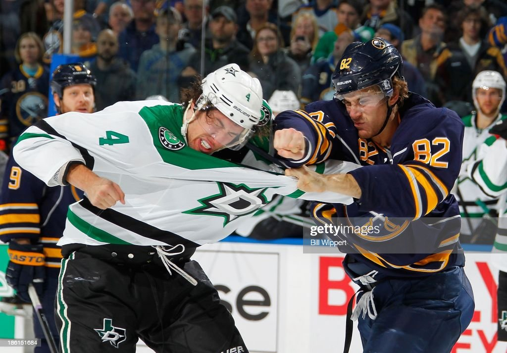 Marcus Foligno #82 of the Buffalo Sabres fights Brenden Dillon #4 of the Dallas Stars on October 28, 2013 at the First Niagara Center in Buffalo, New York.