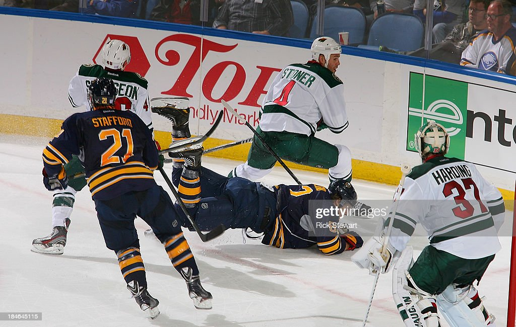 <a gi-track='captionPersonalityLinkClicked' href=/galleries/search?phrase=Marcus+Foligno&family=editorial&specificpeople=5662790 ng-click='$event.stopPropagation()'>Marcus Foligno</a> #82 of the Buffalo Sabres hits the ice during play against the Minnesota Wild at First Niagara Center on October 14, 2013 in Buffalo, New York.