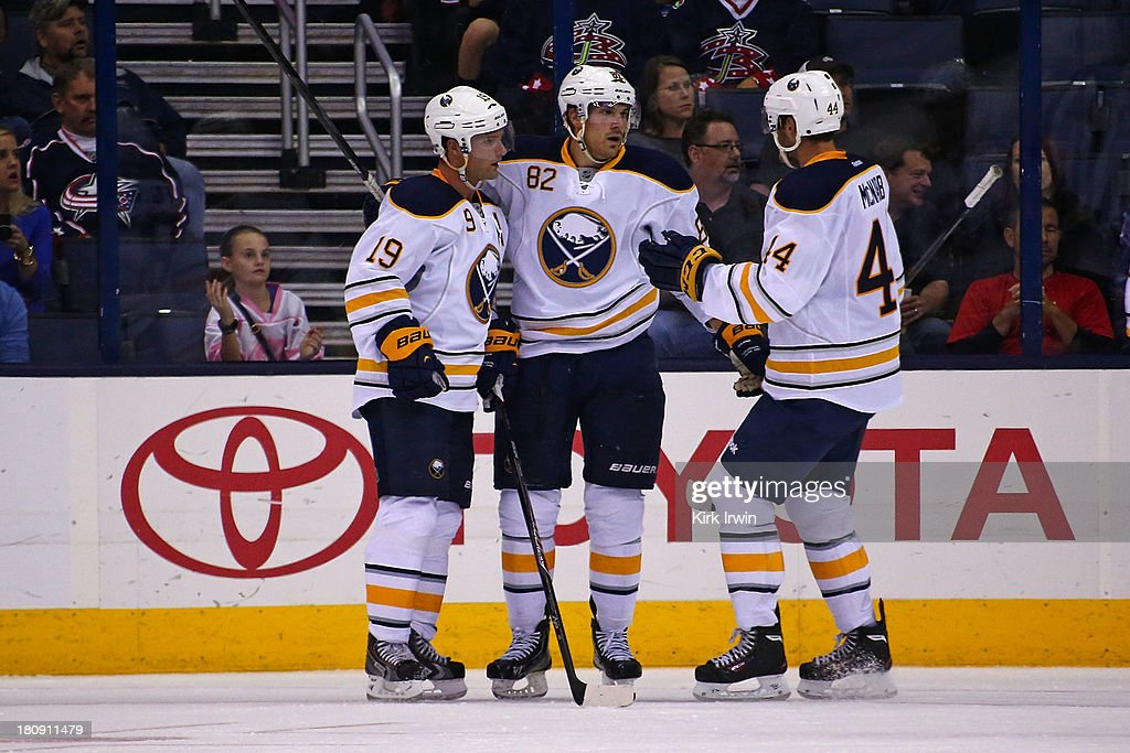 Marcus Foligno #82 of the Buffalo Sabres is congratulated by Cody Hodgson #19 of the Buffalo Sabres and Brayden McNabb #44 of the Buffalo Sabres after scoring his second goal of the game during the second period against the Columbus Blue Jackets on September, 2013 at Nationwide Arena in Columbus, Ohio.