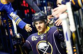 Marcus Foligno of the Buffalo Sabres is greeted by fans before playing the Florida Panthers on October 17 2014 at the First Niagara Center in Buffalo...