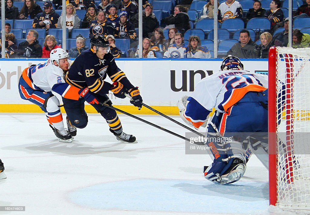 Marcus Foligno #82 of the Buffalo Sabres is stopped by <a gi-track='captionPersonalityLinkClicked' href=/galleries/search?phrase=Mark+Streit&family=editorial&specificpeople=636976 ng-click='$event.stopPropagation()'>Mark Streit</a> #2 and Evgeni Nabokov #20 of the New York Islanders on February 23, 2013 at the First Niagara Center in Buffalo, New York.