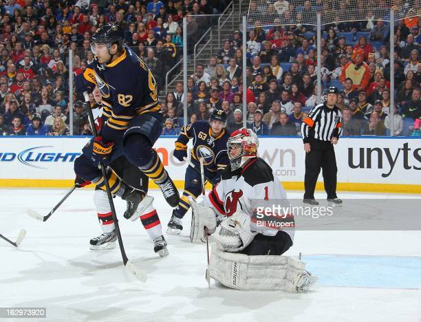 Marcus Foligno of the Buffalo Sabres leaps in the air in an attempt to screen Johan Hedberg of the New Jersey Devils on March 2 2013 at the First...