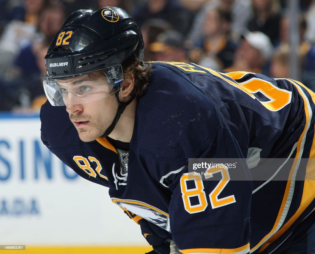 Marcus Foligno #82 of the Buffalo Sabres prepares for a face-off against the New York Islanders at First Niagara Center on April 13, 2014 in Buffalo, New York.