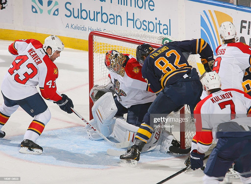 Marcus Foligno #82 of the Buffalo Sabres pressures <a gi-track='captionPersonalityLinkClicked' href=/galleries/search?phrase=Jose+Theodore&family=editorial&specificpeople=202011 ng-click='$event.stopPropagation()'>Jose Theodore</a> #60 of the Florida Panthers at First Niagara Center on February 3, 2013 in Buffalo, New York. Florida won 4-3.