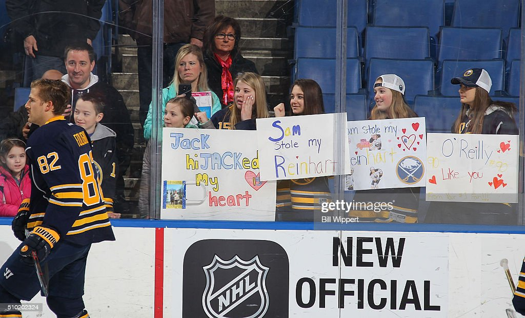 <a gi-track='captionPersonalityLinkClicked' href=/galleries/search?phrase=Marcus+Foligno&family=editorial&specificpeople=5662790 ng-click='$event.stopPropagation()'>Marcus Foligno</a> #82 of the Buffalo Sabres skates as fans hold Valentines Day signs before an NHL game against the Colorado Avalanche on February 14, 2016 at the First Niagara Center in Buffalo, New York.