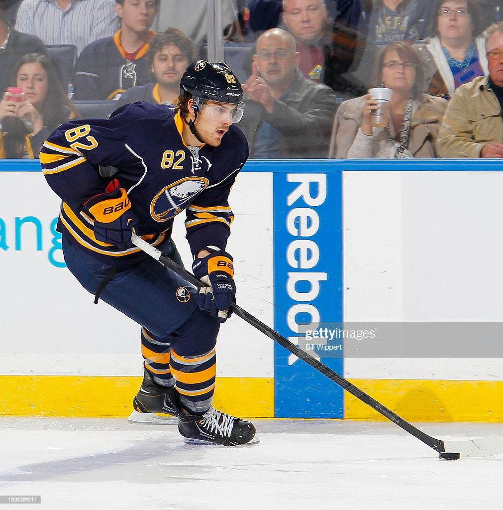 <a gi-track='captionPersonalityLinkClicked' href=/galleries/search?phrase=Marcus+Foligno&family=editorial&specificpeople=5662790 ng-click='$event.stopPropagation()'>Marcus Foligno</a> #17 of the Buffalo Sabres skates with the puck against the Tampa Bay Lightning on October 8, 2013 at the First Niagara Center in Buffalo, New York.