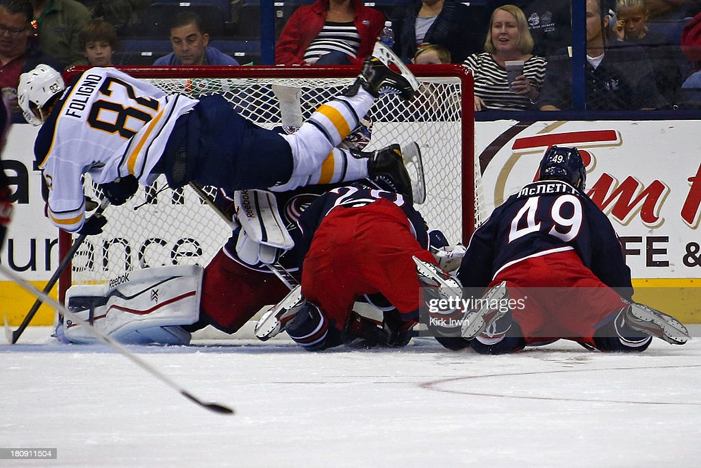 Marcus Foligno #82 of the Buffalo Sabres slides the puck past Sergei Bobrovsky #72 of the Columbus Blue Jackets for his second goal of the game during the second period on September, 2013 at Nationwide Arena in Columbus, Ohio.