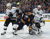 Marcus Foligno of the Buffalo Sabres squeezes between Marian Gaborik and Jhonas Enroth of the Los Angeles Kings during an NHL game on December 12...