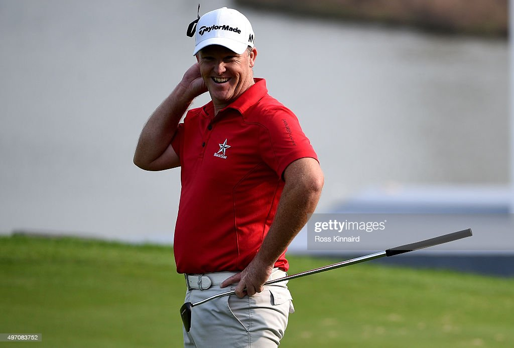 Marcus Fraser of Australia celebrates after making an eagle 2 on the par four 18th hole during the third round of the BMW Masters at Lake Malaren Golf Club on November 14, 2015 in Shanghai, China.