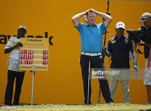 Marcus Fraser of Australia celebrates on the 18th green after winning the fourth round of the Maybank Championship Malaysia at Royal Selangor Golf...