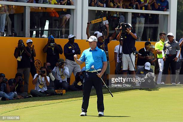 Marcus Fraser of Australia celebrates on the 18th hole after winning the Championship during the fourth round of the Maybank Championship Malaysia at...