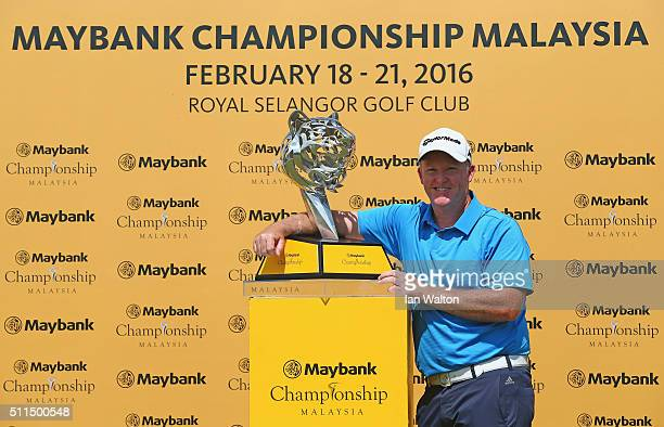 Marcus Fraser of Australia celebrates with the trophy after winning the fourth round of the Maybank Championship Malaysia at Royal Selangor Golf Club...
