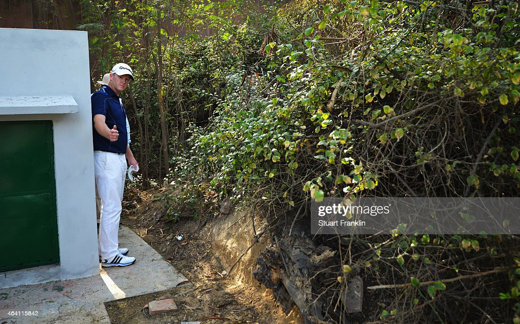 Marcus Fraser of Australia discusses his drop with rules official Gary Tate on the 13th hole during the final round of the Hero India Open Golf at Delhi Golf Club on February 22, 2015 in New Delhi, India.