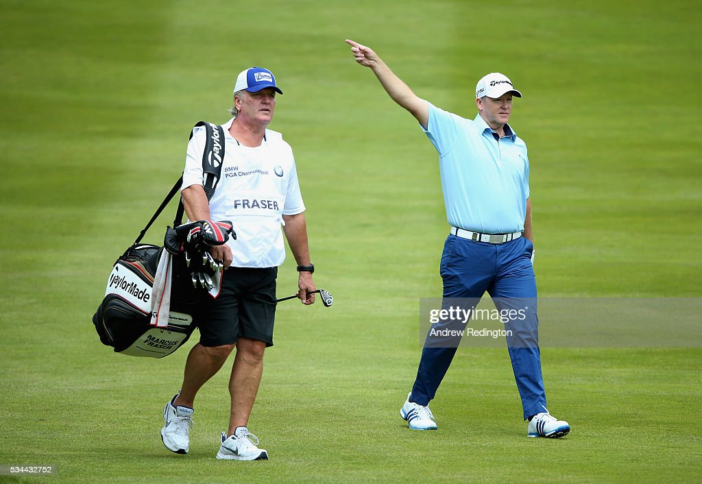 <a gi-track='captionPersonalityLinkClicked' href=/galleries/search?phrase=Marcus+Fraser&family=editorial&specificpeople=240516 ng-click='$event.stopPropagation()'>Marcus Fraser</a> of Australia gestures with caddie Gary Edwards on the 4th hole during day one of the BMW PGA Championship at Wentworth on May 26, 2016 in Virginia Water, England.