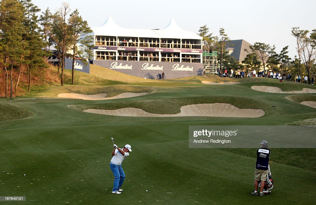 Marcus Fraser of Australia hits his second shot on the 18th hole during the third round of the Ballantine's Championship at Blackstone Golf Club on April 27, 2013 in Icheon, South Korea.
