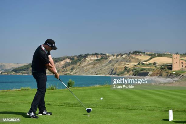 Marcus Fraser of Australia hits his tee shot on the 16th hole during the second round of The Rocco Forte Open at The Verdura Golf and Spa Resort on...