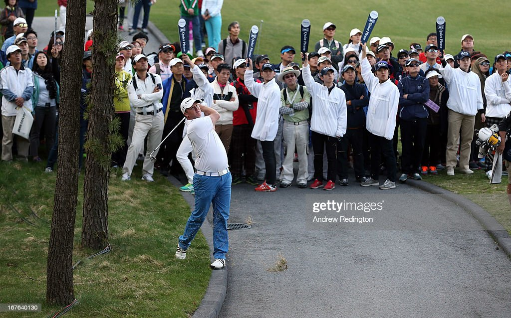 Marcus Fraser of Australia hits his third shot on the 18th hole during the third round of the Ballantine's Championship at Blackstone Golf Club on April 27, 2013 in Icheon, South Korea.