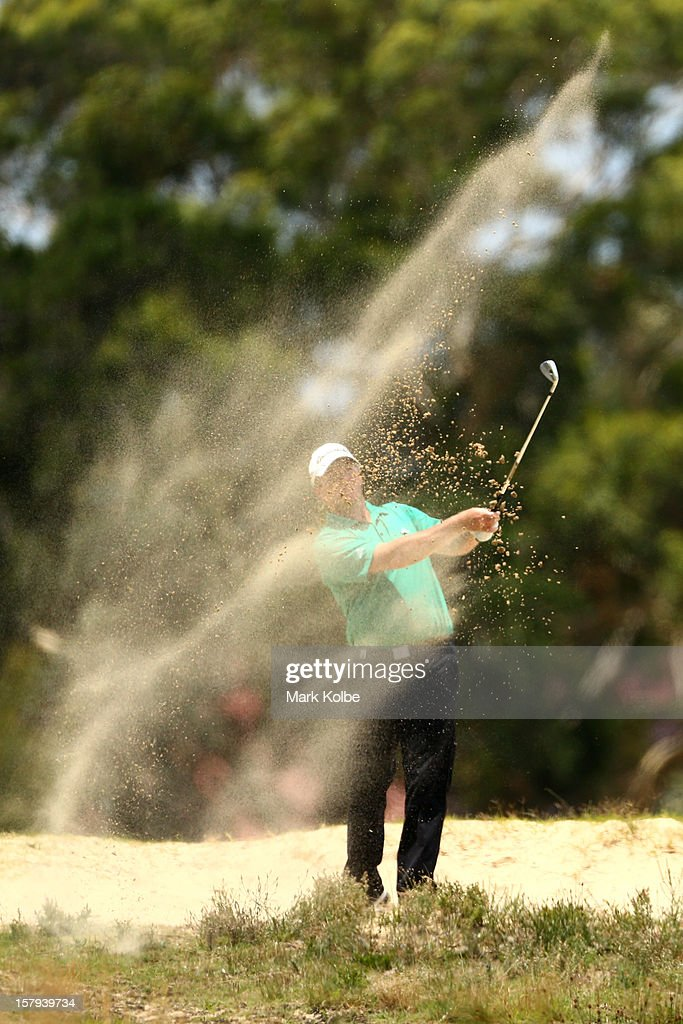 Marcus Fraser of Australia plays a bunker shot during round three of the 2012 Australian Open at The Lakes Golf Club on December 8, 2012 in Sydney, Australia.