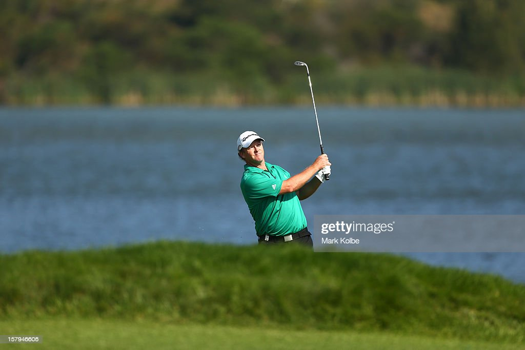 Marcus Fraser of Australia plays a fairway shot during round three of the 2012 Australian Open at The Lakes Golf Club on December 8, 2012 in Sydney, Australia.