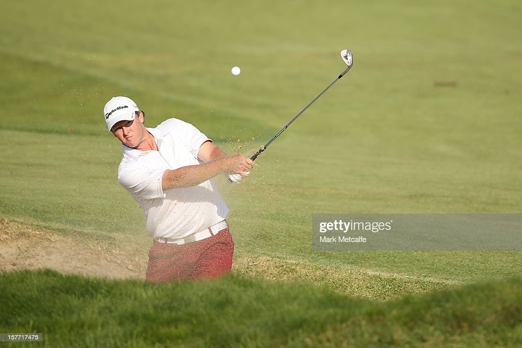 Marcus Fraser of Australia plays a shot during round one of the 2012 Australian Open at The Lakes Golf Club on December 6, 2012 in Sydney, Australia.