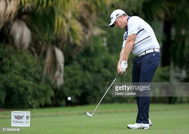 Marcus Fraser of Australia plays his tee shot at the par 3 13th hole during the first round of the 2016 World Golf Championship Cadillac Championship...
