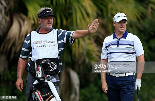 Marcus Fraser of Australia prepares to play his tee shot at the par 3 13th hole with his caddie Garry Edwards during the first round of the 2016...