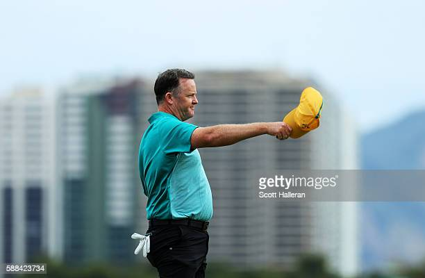 Marcus Fraser of Australia reacts after finishing on the 18th green during the first round of men's golf on Day 6 of the Rio 2016 Olympics at the...