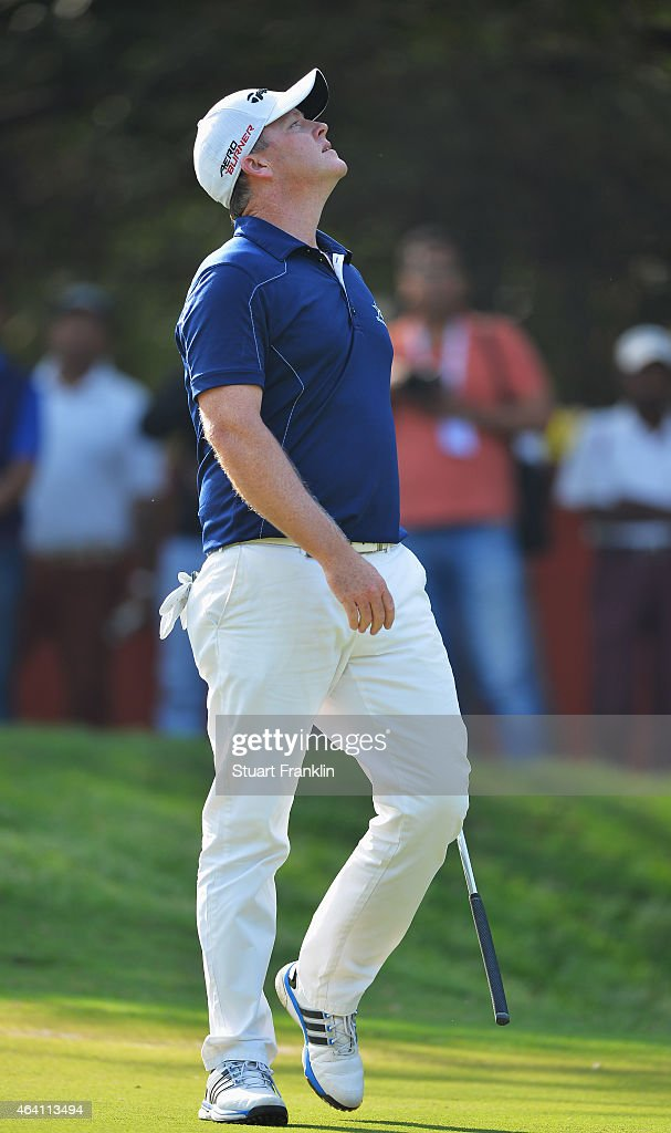 Marcus Fraser of Australia reacts to a shot during the final round of the Hero India Open Golf at Delhi Golf Club on February 22, 2015 in New Delhi, India.