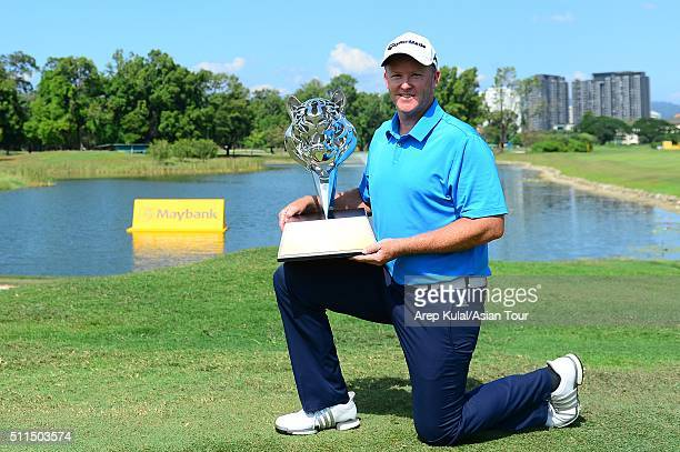 Marcus Fraser pose with the trophy after winning the Maybank Championship Malaysia at Royal Selangor Golf Club on February 21 2016 in Kuala Lumpur...
