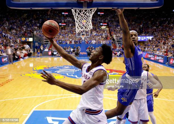 Marcus Garrett of the Kansas Jayhawks drives toward the basket as Chris Howell of the South Dakota State Jackrabbits defends during the game at Allen...
