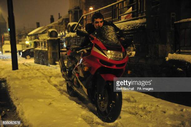 Marcus Gast who is heading from Bristol city centre to Stockwood has to push his motorbike up the A37 as heavy snow has blocked the road after heavy...