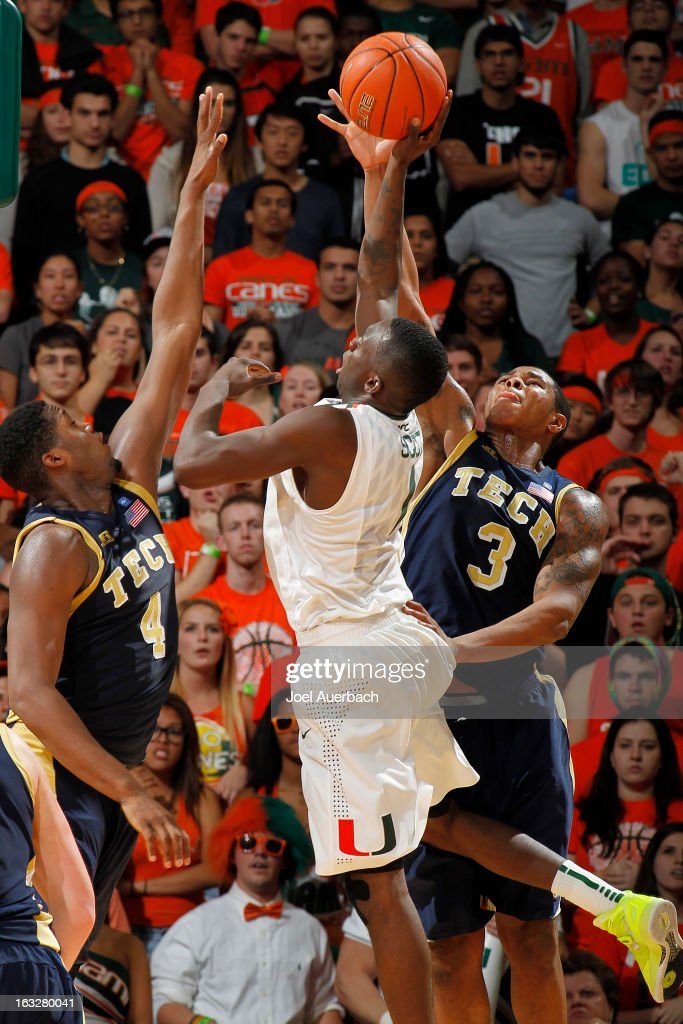 Marcus Georges-Hunt #3 of the Georgia Tech Yellow Jackets blocks the shot by Durand Scott #1 of the Miami Hurricanes on March 6, 2013 at the BankUnited Center in Coral Gables, Florida. Georgi Tech defeated Miami 71-69.