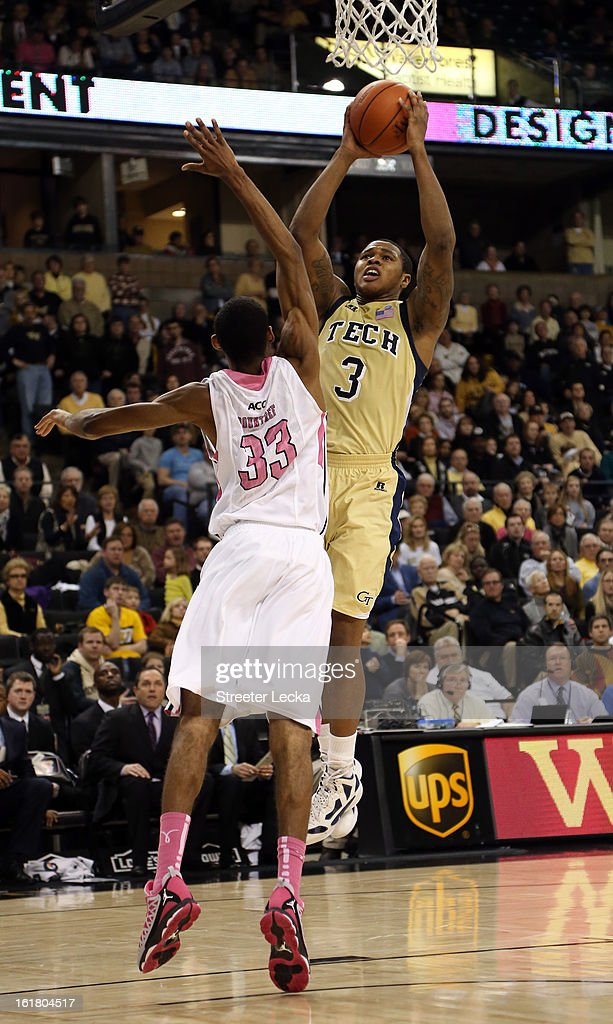 Marcus Georges-Hunt #3 of the Georgia Tech Yellow Jackets drives to the basket against Aaron Rountree III #33 of the Wake Forest Demon Deacons during their game at Lawrence Joel Coliseum on February 16, 2013 in Winston-Salem, North Carolina.