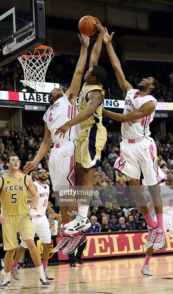 Marcus Georges-Hunt #3 of the Georgia Tech Yellow Jackets goes up to dunk against Devin Thomas #2 of the Wake Forest Demon Deacons and teammate Aaron Rountree III #33 during their game at Lawrence Joel Coliseum on February 16, 2013 in Winston-Salem, North Carolina.