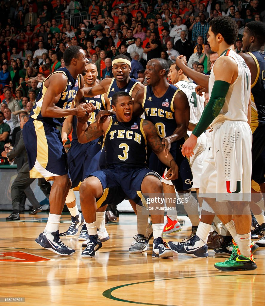 Marcus Georges-Hunt #3 of the Georgia Tech Yellow Jackets is swarmed by teammates after making the game-winning shot against the Miami Hurricanes as the clock ran out on March 6, 2013 at the BankUnited Center in Coral Gables, Florida. Georgi Tech defeated Miami 71-69.