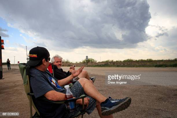 Marcus Gutierrez crew member and driver of the Doppler on Wheels vehicle and meteorologist Josh Wurman president and founder of the Center For Severe...