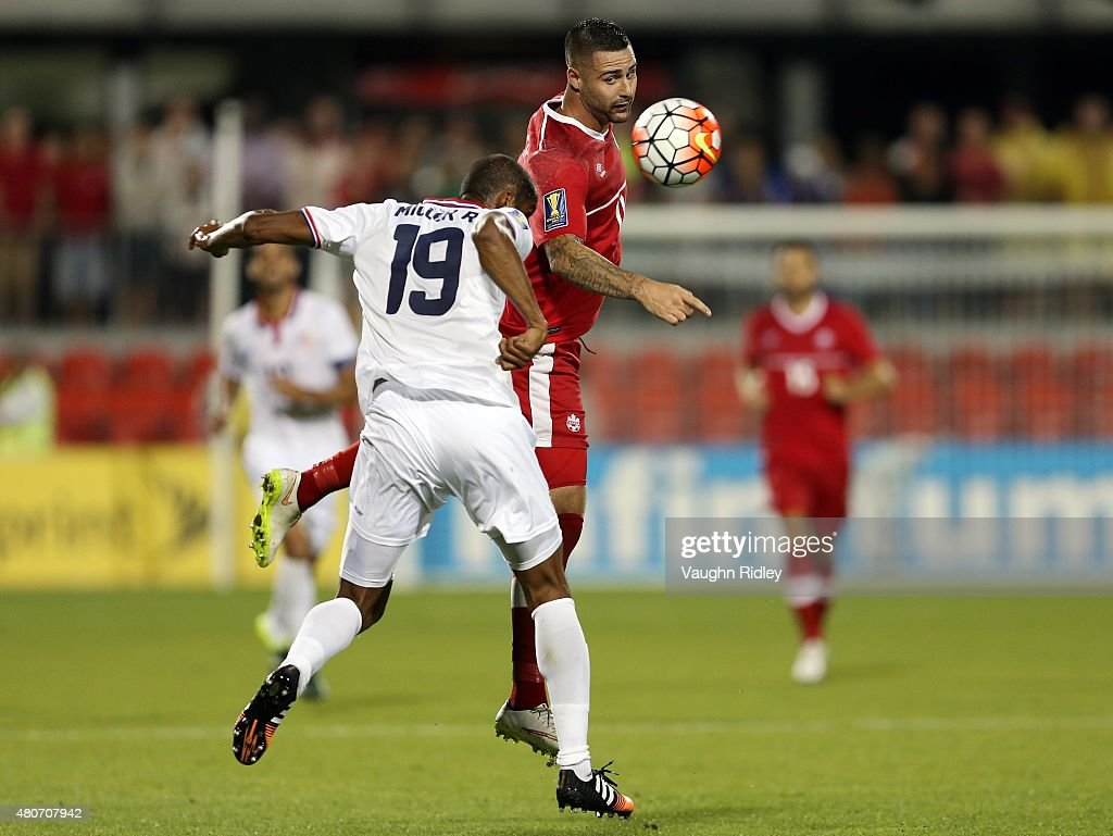 Marcus Haber #11 of Canada and Roy Miller #19 of Costa Rica battle for the ball during the 2015 CONCACAF Gold Cup Group B match between Canada and Costa Rica at BMO Field on July 14, 2015 in Toronto, Ontario, Canada.