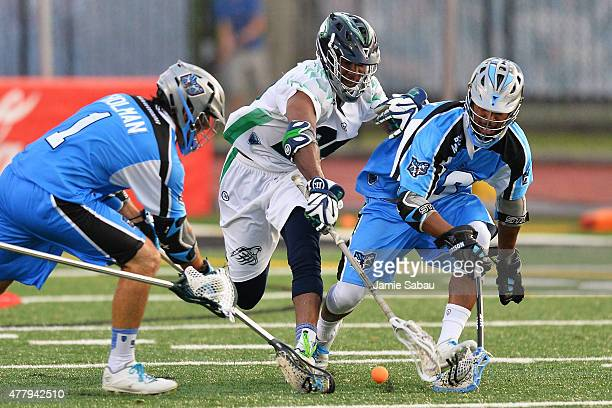 Marcus Holman of the Ohio Machine Mark McNeill of the Chesapeake Bayhawks and Kyle Harrison of the Ohio Machine all chase after a loose ball in the...