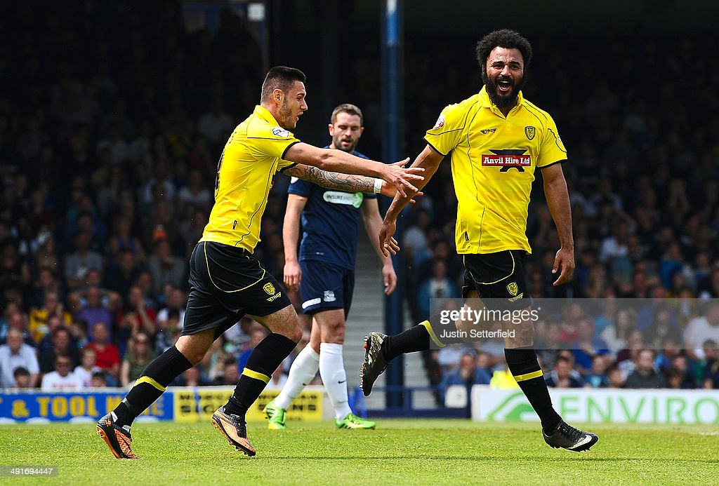 Marcus Holness of Burton Albion celebrates scoring the 1st goal during the Sky Bet League 2 Play Off Semi Final second leg match between Southend United and Burton Albion at Roots Hall on May 17, 2014 in Southend, England.