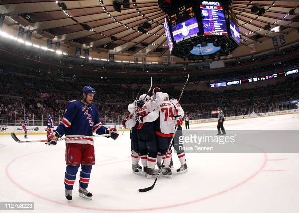 Marcus Johansson and John Carlson of the Washington Capitals celebrate with their teammates after Johansson scored a goal in the third period to tie...