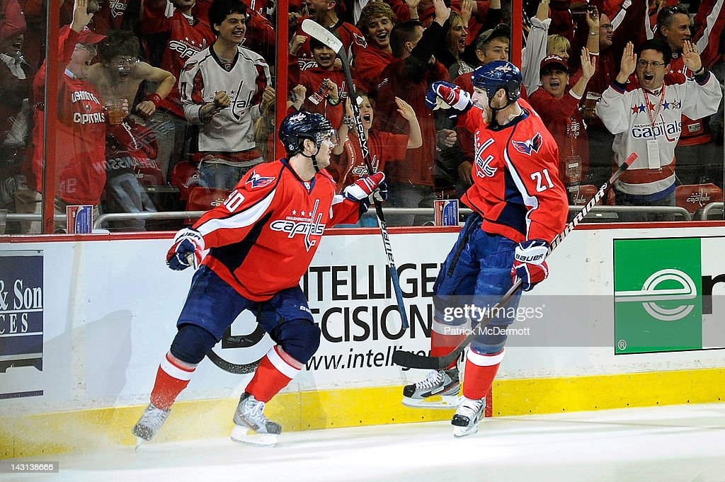 Marcus Johansson celebrates with Brooks Laich of the Washington Capitals after scoring a goal against the Boston Bruins in Game Four of the Eastern...