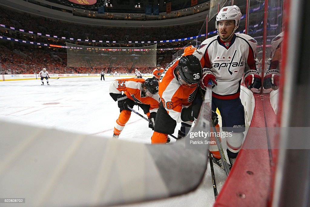 <a gi-track='captionPersonalityLinkClicked' href=/galleries/search?phrase=Marcus+Johansson&family=editorial&specificpeople=4247883 ng-click='$event.stopPropagation()'>Marcus Johansson</a> #90 of the Washington Capitals and <a gi-track='captionPersonalityLinkClicked' href=/galleries/search?phrase=Colin+McDonald+-+Ice+Hockey+Player&family=editorial&specificpeople=10833458 ng-click='$event.stopPropagation()'>Colin McDonald</a> #36 of the Philadelphia Flyers battle for the puck during the third period in Game Four of the Eastern Conference Quarterfinals during the 2015 NHL Stanley Cup Playoffs at Wells Fargo Center on April 20, 2016 in Philadelphia, Pennsylvania.