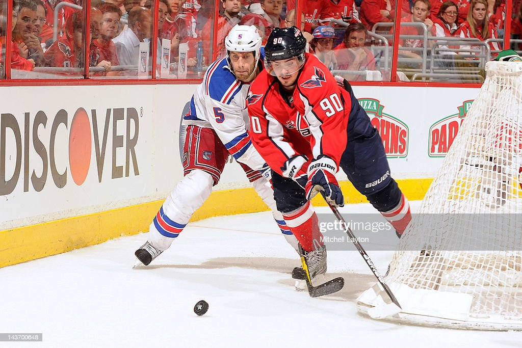 <a gi-track='captionPersonalityLinkClicked' href=/galleries/search?phrase=Marcus+Johansson&family=editorial&specificpeople=4247883 ng-click='$event.stopPropagation()'>Marcus Johansson</a> #90 of the Washington Capitals and Dan Girardi #5 of the New York Rangers fight for the puck during Game Three of the Eastern Conference Semifinals of the 2012 NHL Stanley Cup Playoffs on May 2, 2012 at the Verizon Center in Washington, DC.