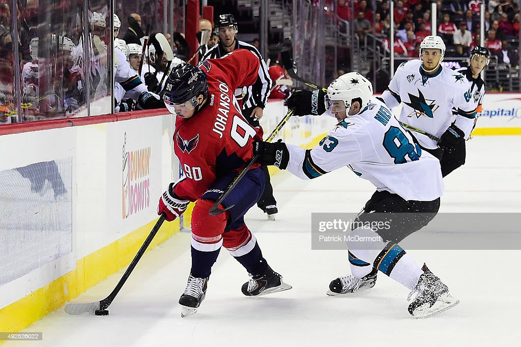 Marcus Johansson #90 of the Washington Capitals and Matt Nieto #83 of the San Jose Sharks battle for the puck in the second period during an NHL game at Verizon Center on October 13, 2015 in Washington, DC.