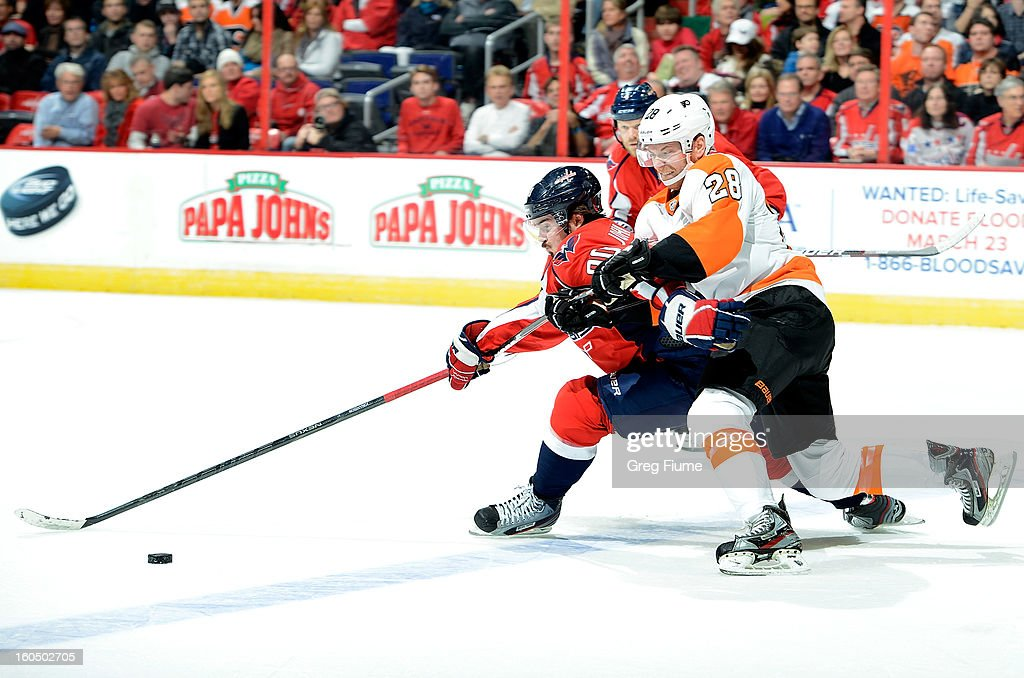 <a gi-track='captionPersonalityLinkClicked' href=/galleries/search?phrase=Marcus+Johansson&family=editorial&specificpeople=4247883 ng-click='$event.stopPropagation()'>Marcus Johansson</a> #90 of the Washington Capitals battles for the puck against <a gi-track='captionPersonalityLinkClicked' href=/galleries/search?phrase=Claude+Giroux&family=editorial&specificpeople=537961 ng-click='$event.stopPropagation()'>Claude Giroux</a> #28 of the Philadelphia Flyers at the Verizon Center on February 1, 2013 in Washington, DC.
