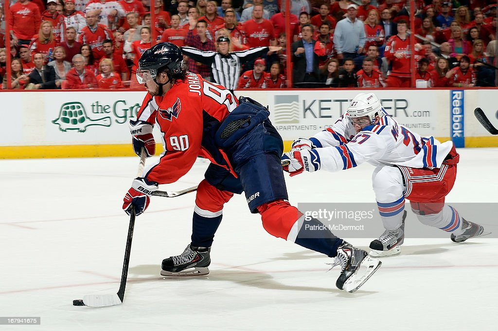 <a gi-track='captionPersonalityLinkClicked' href=/galleries/search?phrase=Marcus+Johansson&family=editorial&specificpeople=4247883 ng-click='$event.stopPropagation()'>Marcus Johansson</a> #90 of the Washington Capitals battles for the puck against <a gi-track='captionPersonalityLinkClicked' href=/galleries/search?phrase=Ryan+McDonagh&family=editorial&specificpeople=4324983 ng-click='$event.stopPropagation()'>Ryan McDonagh</a> #27 of the New York Rangers in the second period of Game One of the Eastern Conference Quarterfinals during the 2013 NHL Stanley Cup Playoffs at Verizon Center on May 2, 2013 in Washington, DC.